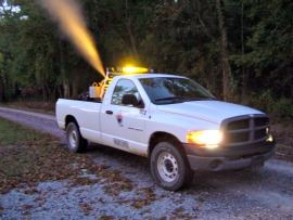 Truck spraying a chemical into the air